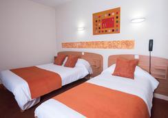 格兰德酒店 - 昂热 - 睡房
