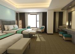 马约酒店 - 曼达维市 - 睡房