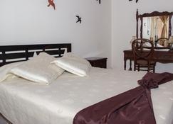 蒙大拿旅馆 - 马尼萨莱斯 - 睡房