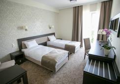 卢克索酒店 - 卢布林 - 睡房