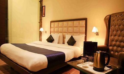 缤旅馆奥尔比恩商场露酒店 - 阿姆利则 - 睡房