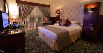 达尔塔克瓦酒店 - 麦地那 - 睡房