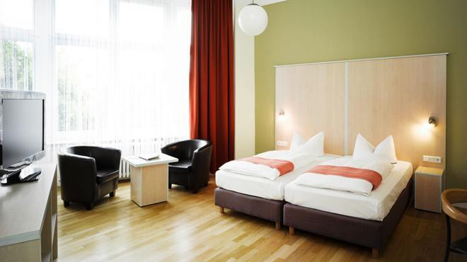 翰萨布里克酒店 - 柏林 - 睡房