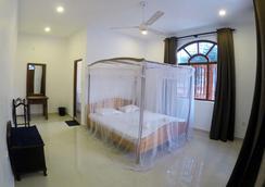 天使宾馆 - 尼甘布 - 睡房