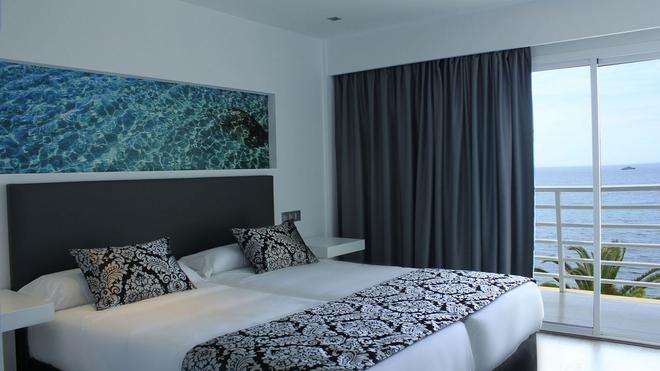 诺蒂科艾本索酒店 - 伊维萨镇 - 睡房