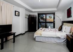 长滩岛海滨别墅酒店 - Malay - 睡房