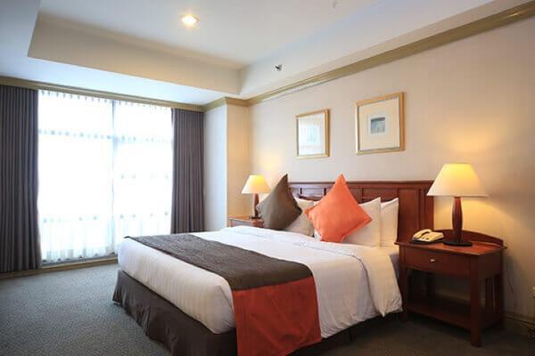 无限大厦套房酒店 - 马卡蒂 - 睡房