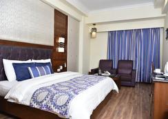 设拉子丽晶酒店 - 阿姆利则 - 睡房