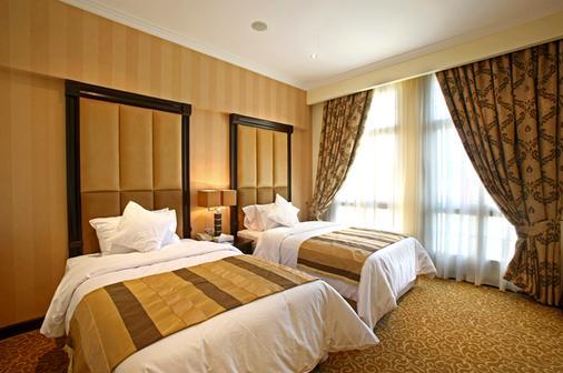 伦敦套房酒店 - 迪拜 - 睡房