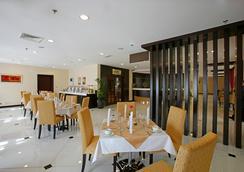 伦敦套房酒店 - 迪拜 - 餐馆