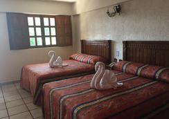 玛丽亚尤金尼亚庄园酒店 - 阿卡普尔科 - 睡房