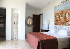 巴厘神秘酒店公寓 - 库塔 - 睡房