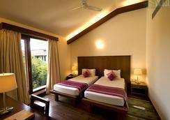 韦迪克村Spa度假酒店 - 加尔各答 - 睡房