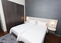 希思明久酒店 - 布加勒斯特 - 睡房