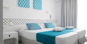 蓝海中午住宅酒店 - 埃尔阿雷纳尔 - 睡房