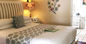 杜瓦尔花园酒店 - 基韦斯特 - 睡房