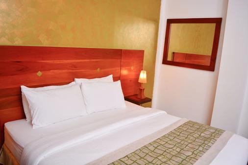 独特大厦豪华精品套房酒店 - 科伦坡 - 睡房