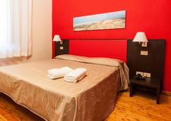 卡萨莱拉斯特帕亚酒店 - 比萨 - 睡房