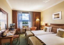 赫利亚丹乌比斯健康温泉度假酒店 - 布达佩斯 - 睡房