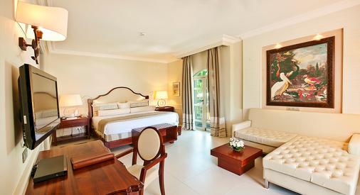 伊贝罗斯塔巴瓦罗大酒店 - 蓬塔卡纳 - 睡房