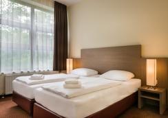 柏林市中心B诺富姆商务酒店 - 柏林 - 睡房