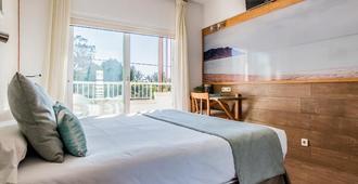 卢克斯岛酒店 - 伊维萨镇 - 睡房