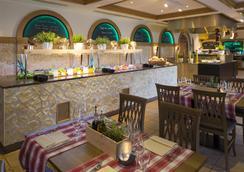 阿卡迪亚洛迦诺H4酒店 - 洛迦诺 - 餐馆