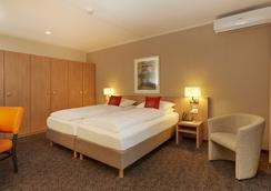 阿卡迪亚洛迦诺H4酒店 - 洛迦诺 - 睡房