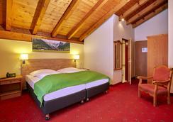 恩格尔贝格桑温德霍夫H+酒店 - 英格堡 - 睡房