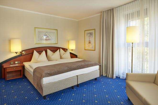 汉堡伯格多夫华美达酒店 - 汉堡 - 睡房