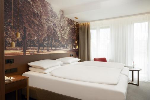 柏林城市中心华美达广场酒店及套房 - 柏林 - 睡房