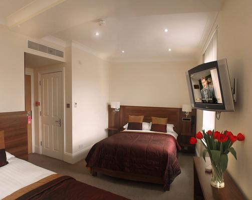 伦敦之家酒店 - 伦敦 - 睡房