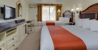 主门东塞拉拉贡酒店和套房 - 基西米 - 睡房