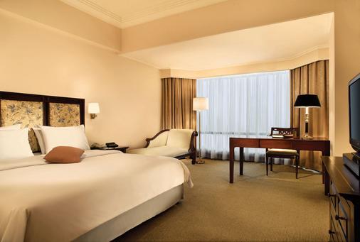 鲁米尔会议酒店 - 雅加达 - 睡房