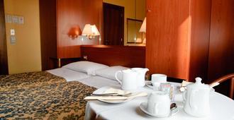 诺芙罗西酒店 - 维罗纳 - 睡房