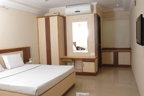斯里西丽晶大酒店 - 海得拉巴 - 睡房