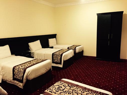 萨瑟阿尔里亚德酒店式公寓 - 麦加 - 睡房
