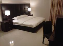 归家酒店 - 瓦迪穆萨 - 睡房
