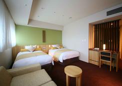 新宿格拉斯丽酒店 - 东京 - 睡房