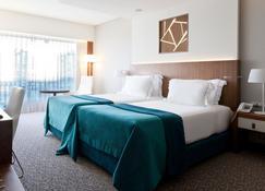 史诗萨那里斯本旅馆 - 里斯本 - 睡房