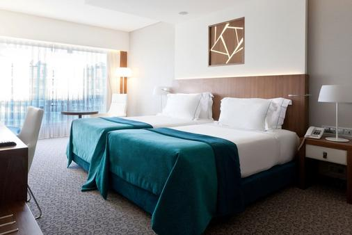 里斯本史诗萨纳酒店 - 里斯本 - 睡房