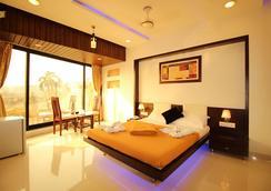 麦特洛酒店 - 孟买 - 睡房