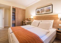 慕尼黑馨乐庭服务公寓酒店 - 慕尼黑 - 睡房