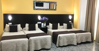 洛斯法罗乐思酒店 - 科尔多瓦 - 睡房