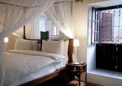 丸丸大酒店 - 桑给巴尔 - 睡房