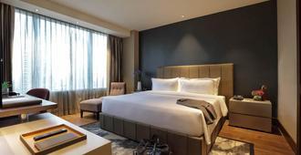 马卡蒂钻石公寓式酒店 - 马卡蒂 - 睡房