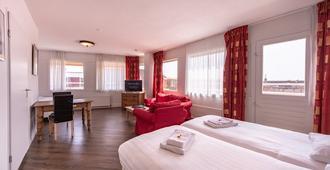 乔普斯城中心酒店 - 哈莱姆 - 睡房