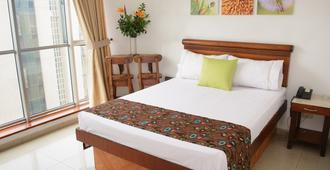 阿卡拉凡酒店 - 麦德林 - 睡房