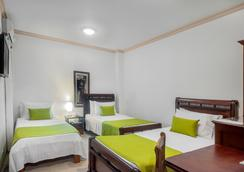 Ms卡斯特拉那康福特酒店 - 卡利 - 睡房