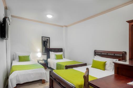 卡斯泰拉纳皇家酒店 - 卡利 - 睡房